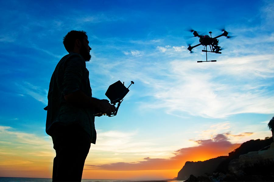 Which FTSE company is planning to use drones to monitor employees' private lives?