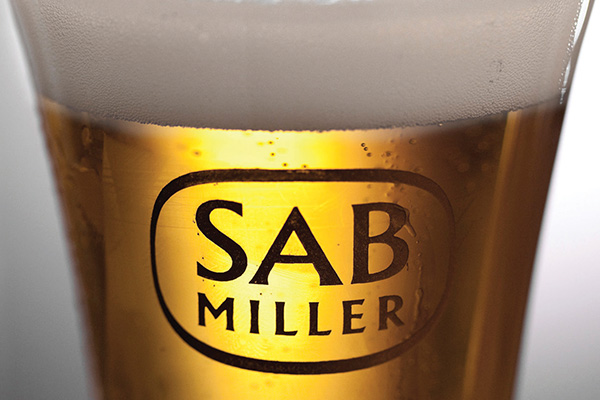 sab miller internationalisation A bartender serves a beer produced by brewing company sab miller at a bar in cape town (file photo.