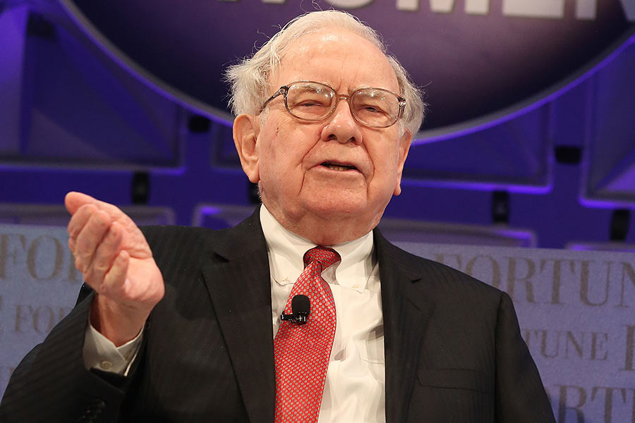 Warren Buffett will give an employee $1m a year for life if they get this right...