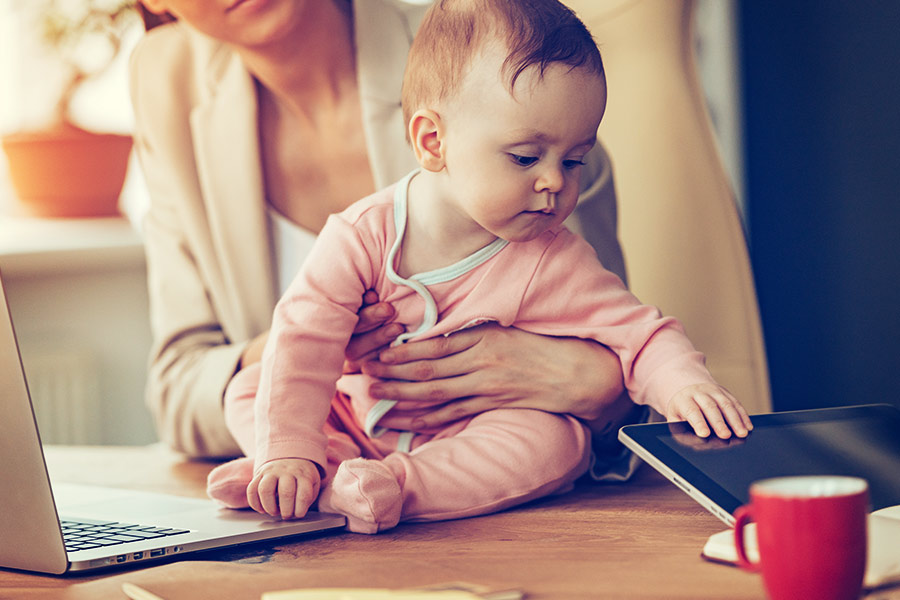 Interviewer breastfeeds baby during interview & divides the internet