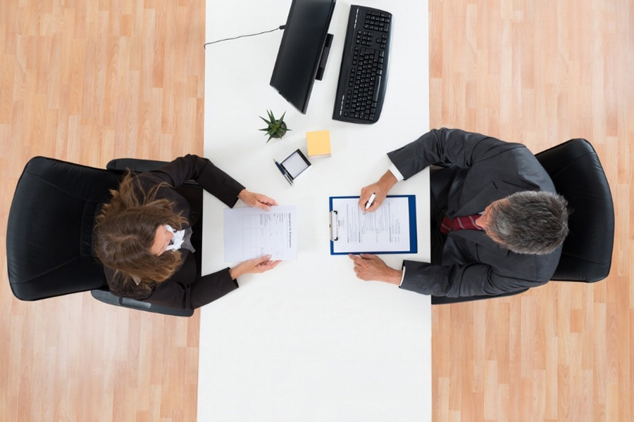 How can structured interviews limit recruiting bias?