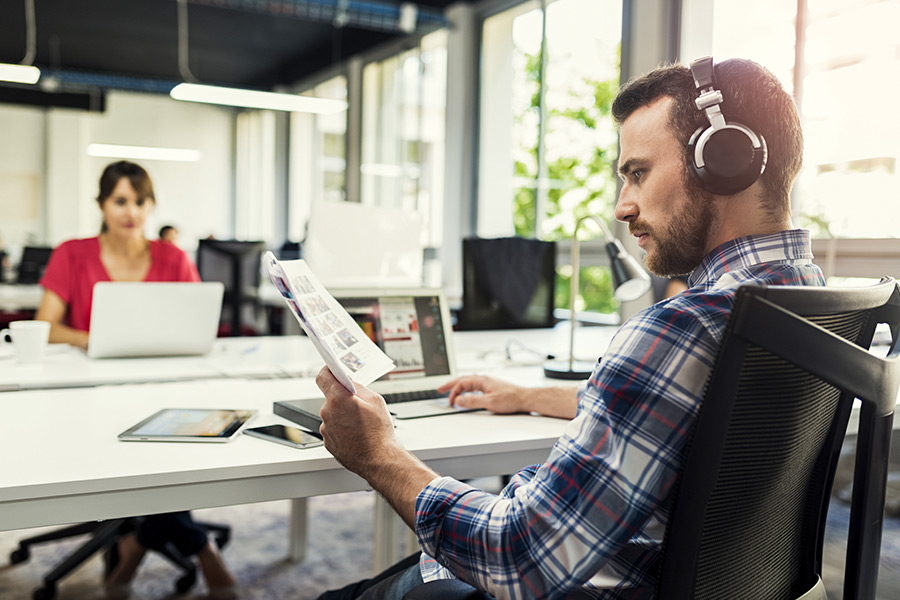 Why are more staff wearing headphones at work?