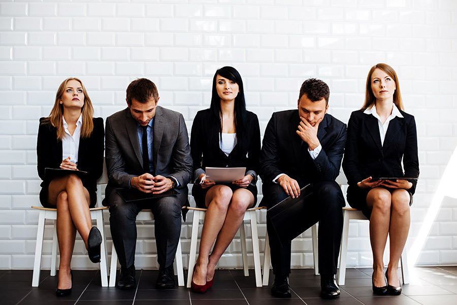 How can candidates portray confidence in a job interview?