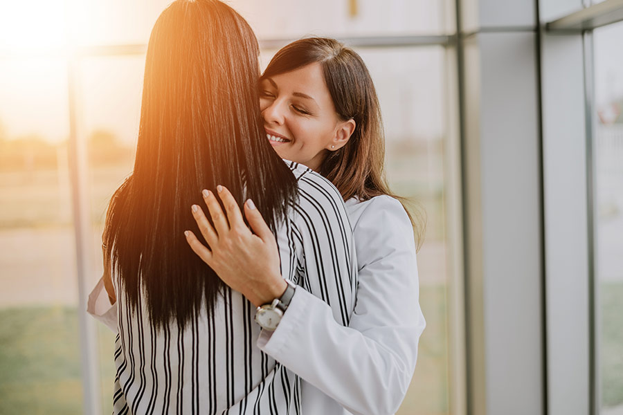 Should hugging be banned in the workplace?
