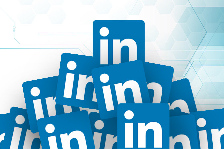 Are LinkedIn's features 'a regressive advertising gambit' or useful rec tool?