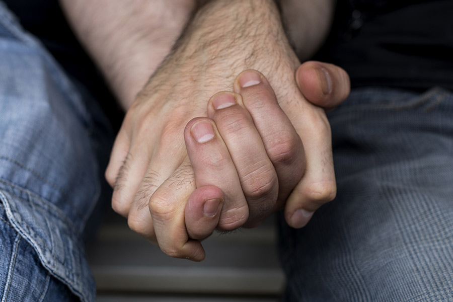 Twitter's on fire with men holding hands in support for LGBT