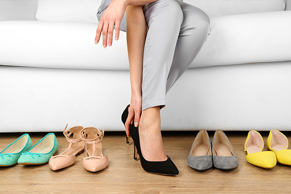 Temp worker sent home from PwC office for not wearing heels