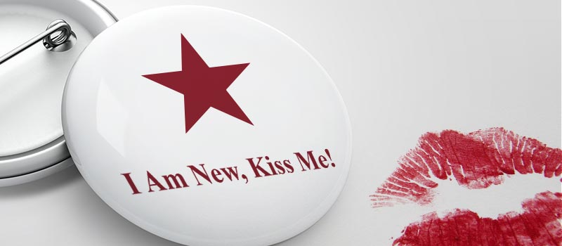 Female Pret worker spotted wearing 'I'm new kiss me!' badge