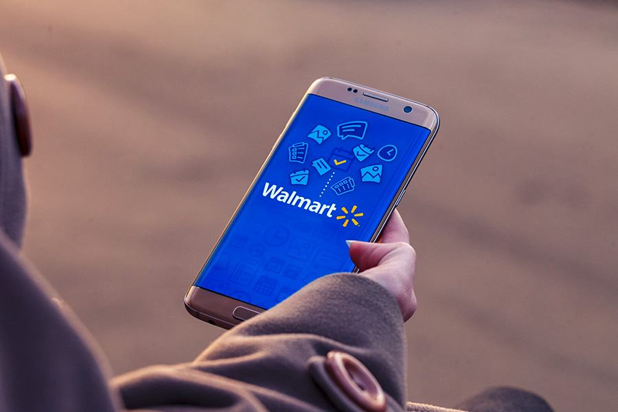 Walmart urges workers to use their phones on shift